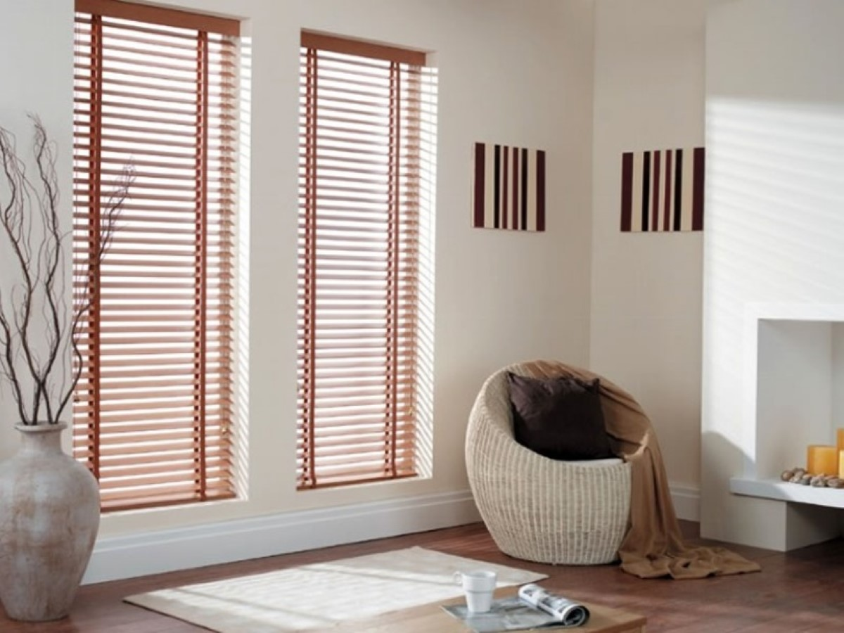 plain-white-wall-paint-color-background-with-decorative-braid-round-chair-near-vinyl-window-blinds.jpg
